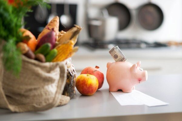 fall produce with a piggy bank