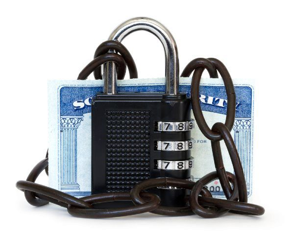 lock and chain with social security card