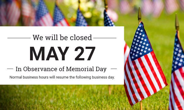 sign for memorial day closure with american flags